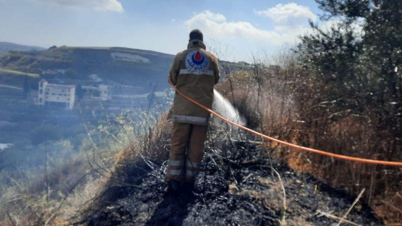 إخماد حريق أعشاب يابسة وزيتون في بلدة بريقع الجنوبية